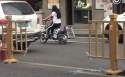 Trung Quốc: Chồng bí mật cắt rào chắn đường ray để vợ đi làm cho tiện