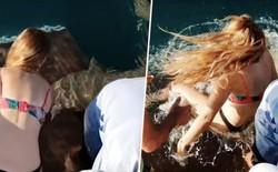 Úc: Cô gái bị lôi xuống nước, suýt mất ngón tay vì cho cá mập ăn