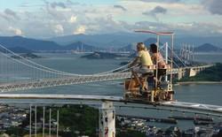 Phải là người bạo gan lắm mới dám đạp xe trên đường ray cao tới hàng chục mét này tại Nhật Bản