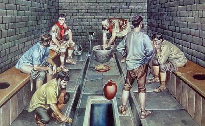 Kinh dị chuyện nhà vệ sinh công cộng thời La Mã, nơi tất cả mọi người chùi chung bằng 1 cái que